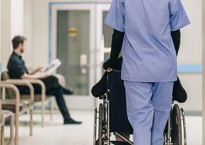 nurse pushing patient